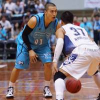 Effective debut: Kyoto's Masaharu Kataoka (91), seen in this file photo, scored 18 points in the Hannaryz's 79-69 playoff-opening win over the Shiga Lakestars on Saturday. | THE JAPAN TIMES