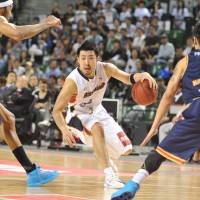 Drive and dedication: Yokohama's Masayuki Kabaya moves the ball during the B-Corsairs' 101-90 win over the Rizing Fukuoka in the bj-league championship game at Ariake Colosseum on Sunday. | YOSHIAKI MIURA