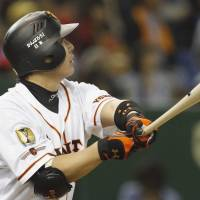 Lead by example: Yomiuri captain Shinnosuke Abe has been one of the driving forces behind the success of the first-place Giants this season. | KYODO