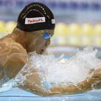Winning technique: Decorated Olympian Kosuke Kitajima competes in the men's 100-meter breaststroke at the Japan Open on Friday in Sagamihara, Kanagawa Prefecture. | KYODO