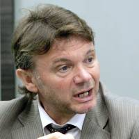 Leaps and bounds: Former national team manager Philippe Troussier, pictured in a 2010 interview, believes Japan is now among the world's top 15 teams. | KYODO