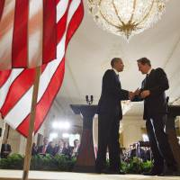 Put 'er there: U.S. President Barack Obama shakes hands with British Prime Minister David Cameron at the conclusion of their joint news conference in Washington on Monday. | AP