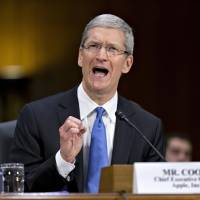 Vigorous defense: Apple CEO Tim Cook testifies in Washington on Tuesday. | AP