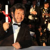 Savoring the moment: Japanese director Hirokazu Koreeda is seen after being awarded the Prix du Jury (Jury's Prize) for his film 'Like Father, Like Son' at the 66th Cannes Film Festival in Cannes, France, on Sunday. | AFP-JIJI