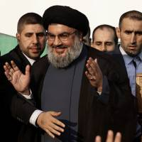 'Real friend': Hezbollah leader Sheik Hassan Nasrallah waves to supporters in Beirut last September. | AP