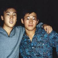 Jailed: Kenneth Bae (right) and a friend pose for a photo when they were freshmen students at the University of Oregon in 1988. | AP
