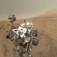 Martian landscape: NASA's Curiosity rover used the Mars Hand Lens Imager on its robotic arm to capture 55 high-resolution images, which were stitched together in October to create this self-portrait. The mosaic shows the rover at 'Rocknest,' the spot in Gale Crater where the mission's first scoop sampling took place. | THE WASHINGTON POST