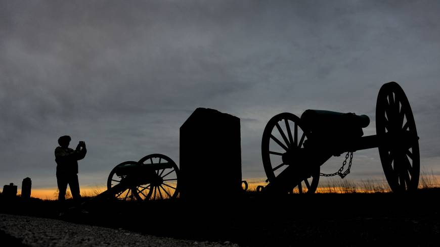 Echoes: Kelli Flory, a teacher from Union, Michigan, takes a photo of the cannons at the Pennsylvania Memorial at Gettysburg National Military Park.