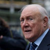 Fall from grace: Former BBC presenter Stuart Hall is seen here in this Feb. 7 photo. Earlier this month, the 83-year-old sports broadcaster pleaded guilty to multiple assaults on young girls as far back as the 1970s. | AP