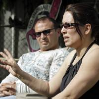 Elida Caraballo (right) and her husband, Frank, talk about the abuse her late sister, Grimilda Figueroa — Castro's common-law wife — suffered at his hands, during an interview in Cleveland on Thursday. | AP
