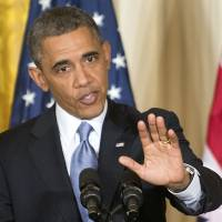 Internal heat: President Barack Obama speaks during a joint news conference with British Prime Minister David Cameron on Monday in the East Room of the White House in Washington. | AP