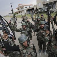 Boots on the ground: Syrian troops celebrate as they take control of the village of Haydariyah, some 7 km outside the rebel-held city of Qusayr, on Monday. | AFP-JIJI