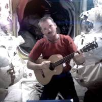Houston, we have a superstar: Crooning astronaut Hadfield's enthusiasm goes viral down on Earth