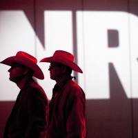 Name of the game: National Rifle Association members listen to speakers during the Annual Meeting of Members on May 4 in Houston. | AP