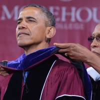 Role model: U.S. President Barack Obama is presented with an honorary doctor of law degree after delivering the commencement address during a ceremony that was held on Sunday at historically black Morehouse College in Atlanta. | AFP-JIJI