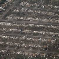 Tornado path: An aerial photo shows the remains of homes hit by a massive twister in Moore, Oklahoma, on Monday. | AP