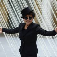 Starting over: Artist Yoko Ono poses in front of one of her works at her exhibition in Frankfurt, Germany, in February. Now 80, she says she feels like she is just beginning 'a second life that will have so many things i didn't have in the first life.' | AP