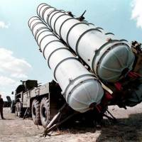 Locked and loaded: A picture taken in 1996 shows S-300 air defense missiles being prepared for launch at a military training ground in Russia. | AFP-JIJI