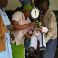 A nurse weighs a baby at a clinic in Moshi, Tanzania, in July 2010. | ZENSHO HOLDINGS CO.