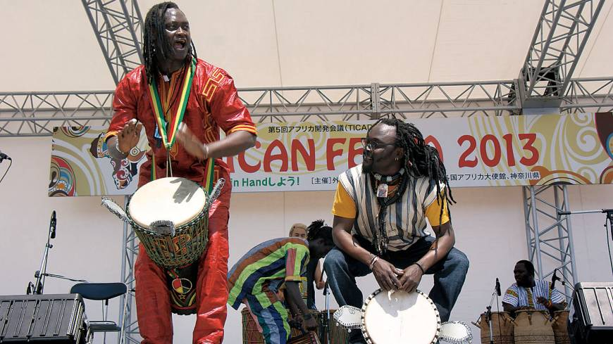 Percussionists perform at the African Festa 2013, held on the occasion of TICAD V, in the conference's host city of Yokohama last month. | CITY OF YOKOHAMA