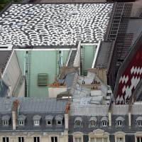 Scaling the heights: Aboriginal artist Lena Nyadbi's artwork on the roof of the Quai Branly museum in Paris, titled 'Dayiwul Lirlmim' ('Barramundi Scales'), is seen during its inauguration on  Thursday. | AFP-JIJI