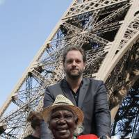 Dream time: Lena Nyadbi poses next to the Eiffel Tower for the inauguration of her painting on  Thursday. | AP