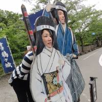 Say cheese: A kaohamepanel in front of a gift shop near Tsuruga Castle in Aizu-Wakamatasu, Fukushima Prefecture. The male character represents the Byakkotai, a group of teenage samurai who committed suicide after a battle there in 1868. The female character represents the women who fought alongside the men.