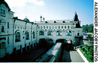 Vladivostok and Primorye offer a rewarding combination of architectural and natural beauty. Vladivostok Station (above) is the city's most imposing landmark, reminiscent of a 17th-century palace. In the countryside, rustic buildings such as this dacha blend unobtrusively with the forest.