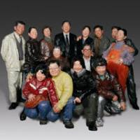 Putting on a smile: A family squeeze together for a portrait snapshot in Liu Qing's sculpture 'Say Cheese' (2008).   COURTESY OF THE NARA PREFECTURAL MUSEUM OF ART