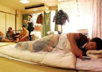 Regular guys, irregular lives: Young, potential sumo stars hang out in their quarters in the film 'Une Vie Normale.'