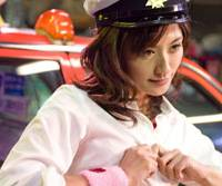 Ready for action: Tomomi Miyauchi plays a cab driver in 'Ushiro kara Mae kara' and gives her customers more than just a ride home.