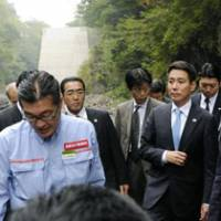 Time to give a dam: Land minister Seiji Maehara (right) visits the proposed site for Yamba Dam in Naganohara, Gunma Prefecture, last year. | KYODO PHOTO