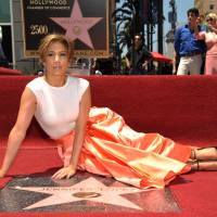 On the floor: Jennifer Lopez with her new star on the Hollywood Walk of Fame. | AP