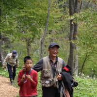 Shared delight: A visually disadvantaged boy and his guide in a 'Kokoro no Mori' ('Forest Heart') program in our Afan woods savor the joys of nature together.