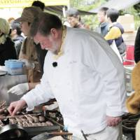 Waste not — want a lot: Chef Nicol makes griddles of venison sausages sizzle at the C.W. Nicol Afan Woodland Trust's Forest Kitchen booth set up as part of the annual Earth Day Tokyo weekend in April. Whenever venison is on the menu at public events like this, all the dishes invariably sell out well before the end. | CONAN MORIMOTO