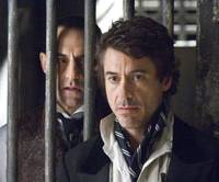 Sexy sleuth: Robert Downey Jr. (right) takes on the role of famed detective Sherlock Holmes, with Mark Strong (left) playing the role of the villainous Lord Blackwood.   © 2009 VILLAGE ROADSHOW FILMS (BM) LIMITED