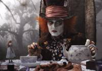 Tea for two: Alice (Mia Wasikowska) joins the Mad Hatter (Johnny Depp) for a cuppa in Tim Burton's 'Alice in Wonderland.' | © DISNEY ENTERPRISES, INC. ALL RIGHTS RESERVED.