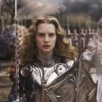 Fantasyland: A still from Tim Burton's 'Alice in Wonderland' shows Johnny Depp as the Mad Hatter (left), Mia Wasikowska as Alice (center) and Anne Hathaway as the White Queen. | © DISNEY ENTERPRISES, INC. ALL RIGHTS RESERVED.