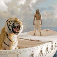 All at sea: Young shipwreck survivor Pi (Suraj Sharma) shares a lifeboat with a Bengal tiger by the name of Richard Parker in 'Life of Pi,' director Ang Lee's adaptation of the best-selling novel by Yann Martel. The film has been nominated for 11 Oscars, including Best Picture, Best Director and Best Visual Effects. | © 2012 TWENTIETH CENTURY FOX