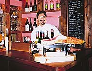 Chef/owner Jitsuhiro Yamada (top) stands behind the bar, while the interior offers the discerning diner a welcome spot to treat his appetite.