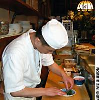 Chef Maki Isogai prepares another prime morsel at this classic sushi shop in the heart of Tsukiji Uogashi.