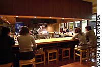 Customers flock to yakitori legend Bird Land in Ginza (above) where master Toshihiro Wada presides over the grill.