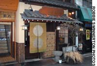 The rustic facade of Shinpachi (above) conceals a slice of shitamachi life. Among the Edokko comfort foods served in this traditional Kanda eatery is fugu-chiri hotpot.