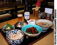 Wash down Shimauta Paradise's Okinawan cuisine with the prefecture's own Orion Beer (above), or some fiery awamori liquor straight from the vats. | ROBBIE SWINNERTON PHOTO