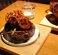 Fowl flavors: Grilled chicken and burdock root on a hot stone.