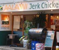A belly full: Aalawi serves up tasty jerk chicken (below), the spicy barbecue that has become Jamaica's de facto national dish, in a laid-back corner of Ebisu. | ROBBIE SWINNERTON PHOTOS