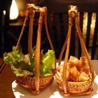 A taste of southern hospitality: Served in bamboo baskets, the  cha gio  (deep-fried spring rolls) at The Majestic, a Vietnamese restaurant in Aoyama, are not to be missed. | ROBBIE SWINNERTON PHOTO