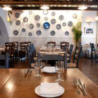 Island style: With its rustic accents, Tharros' dining room is informal enough for a light meal but tasteful enough for a leisurely night out. | YOSHIAKI MIURA PHOTO