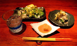 Classic Okinawan dishes served at Taketomijima include goya champuru (stir-fry with bitter melon, slivers of pork and tofu) and tofuyo (fermented tofu), best accompanied by a glass of awamori.