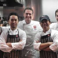 Warm welcome: Mario Frittoli (center) with his kitchen crew
